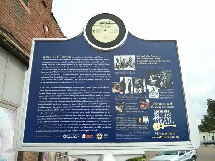 Other side of the trail marker outside the Highway 61 Blues Museum