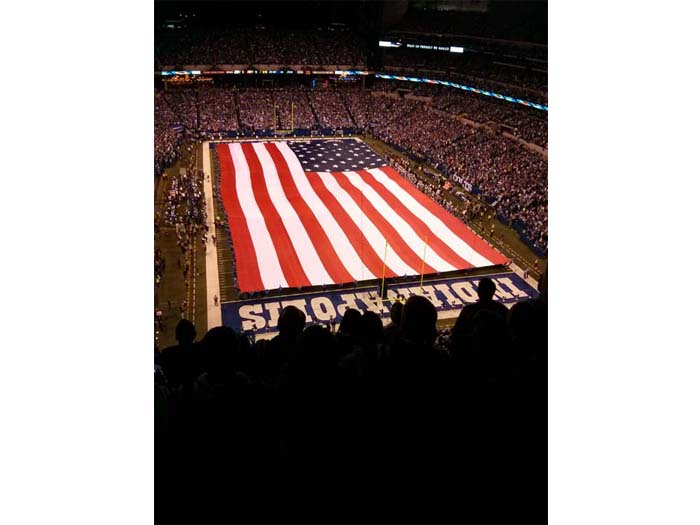 Flag covering the field for the national anthem at Lucas Oil Stadium