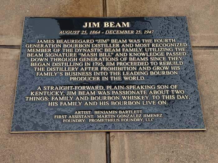 Plaque by statue of Jim Beam