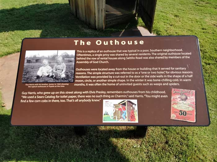 Sign describing an outhouse